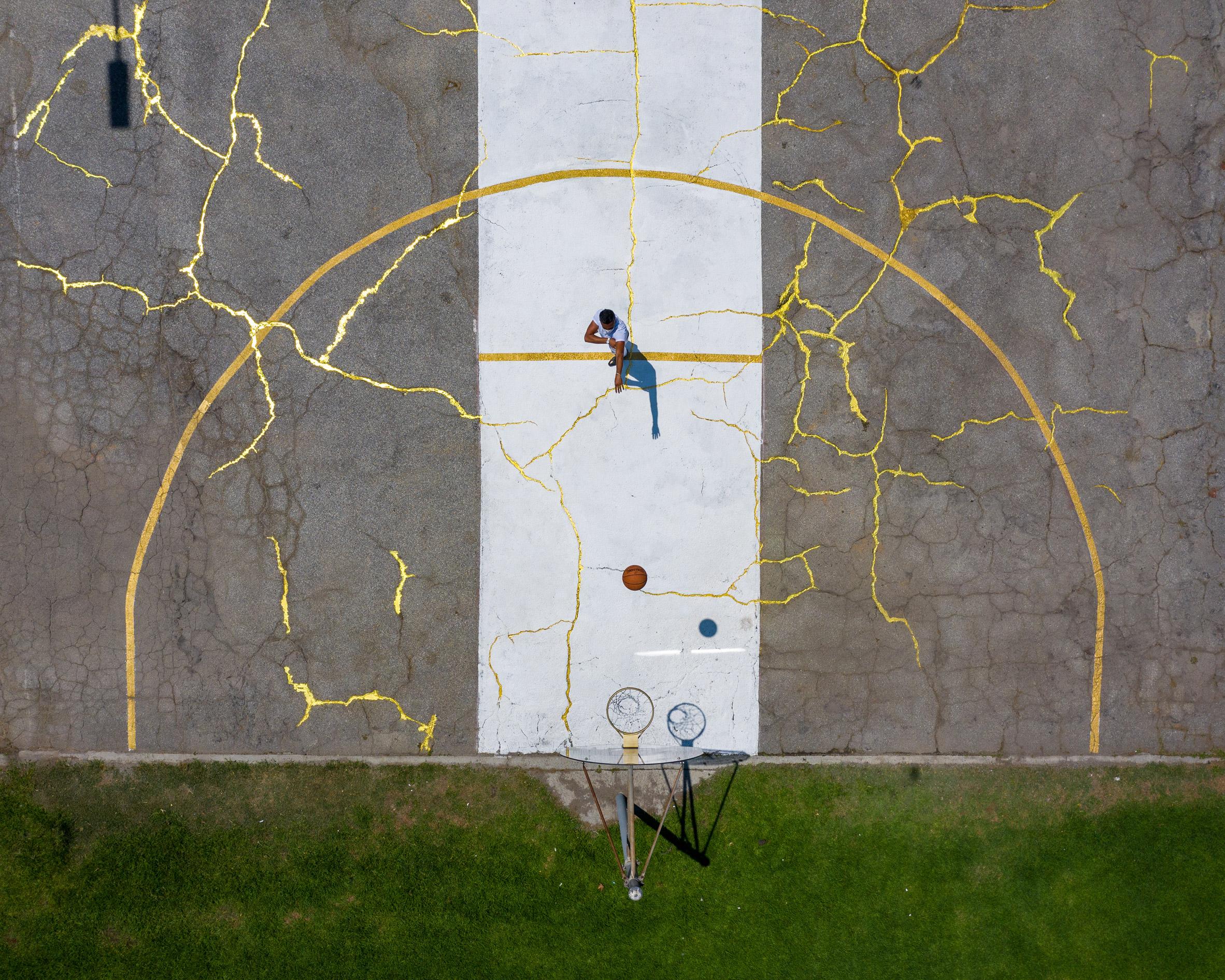 Victor Solomon mends LA basketball court using Japanese art of Kintsugi