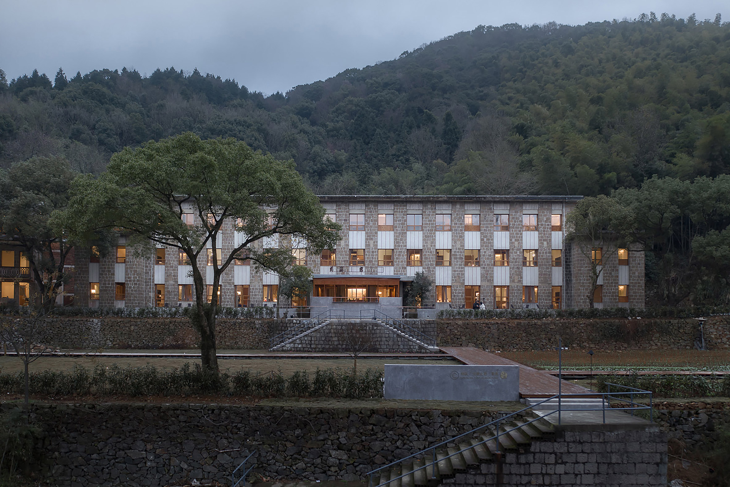 Atelier XÜK converts disused Chinese primary school into boutique hotel