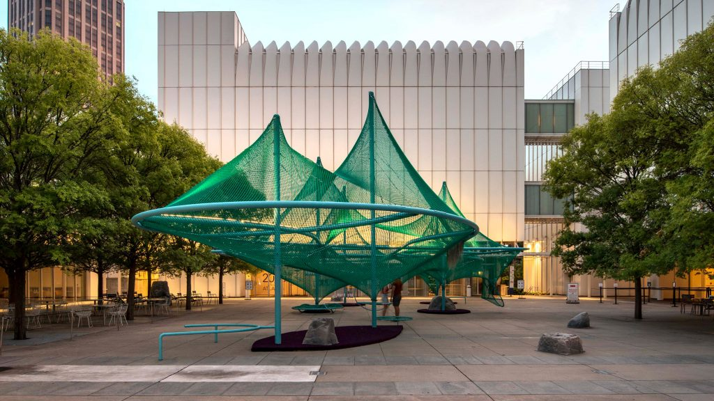 Green net installation Murmuration by SO-IL features hammocks and bird feeders