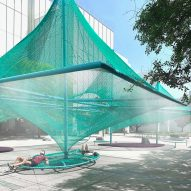 Green net shades hammocks and bird feeders in Murmuration by SO-IL