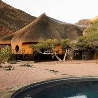 The Nest at Sossus guesthouse in Namibia features a thatched facade