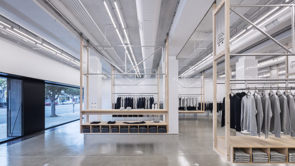 Clothing racks move along wheeled tracks in LA store Reigning Champ