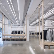 Clothing racks move along wheeled tracks in Los Angeles athletic store Reigning Champ