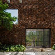 CTA Creative Architects uses perforated bricks to form Wall House in Vietnam