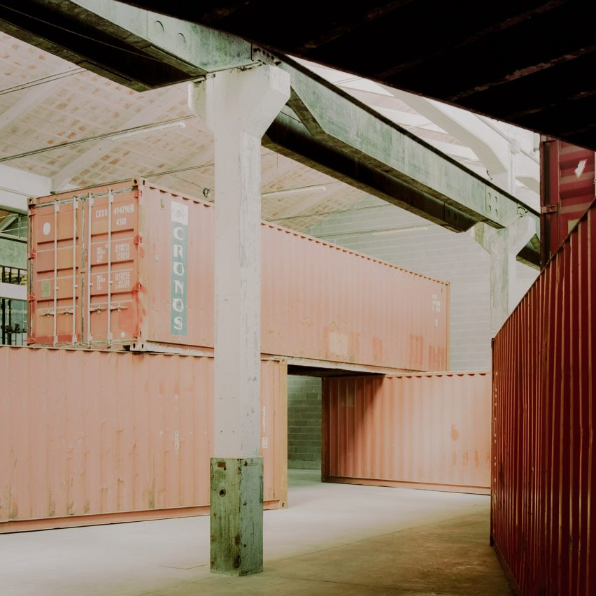 AMAA stacks shipping containers in Italian factory to create Space within a space