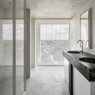 Bathrooms in Belgian apartment feature marble sinks