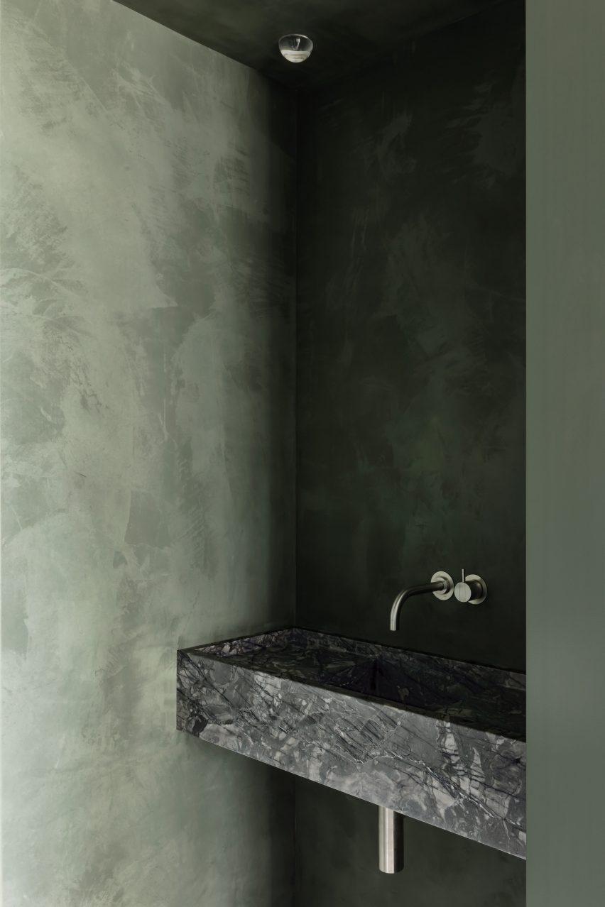 Green bathroom features in Belgium apartment