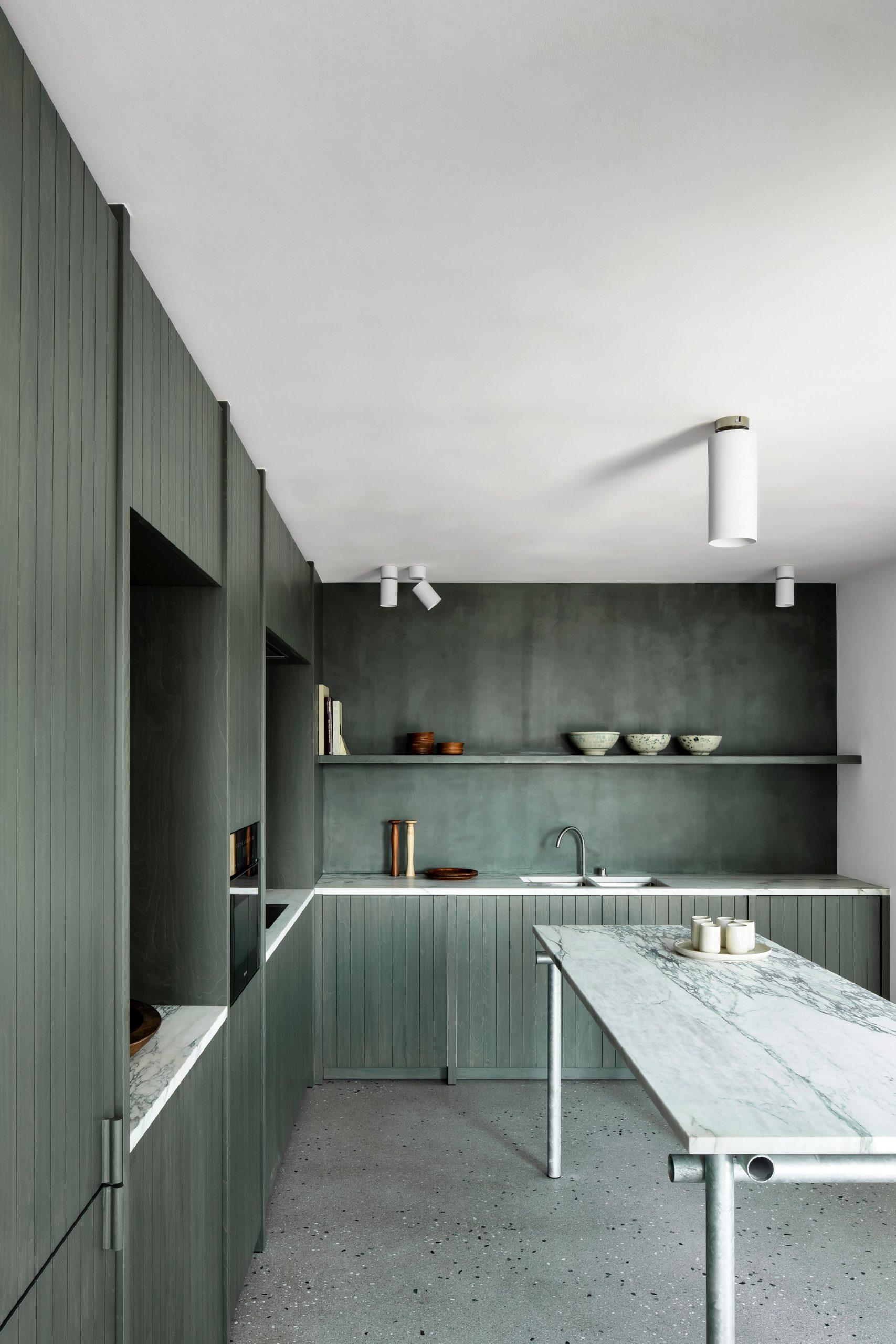 Apartment in Belgium has green birch-wood kitchen