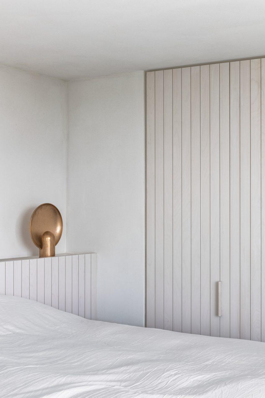 Belgium apartment includes white bedroom
