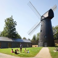 Timber community centre built alongside London's last windmill
