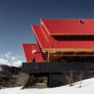 Red roofs are layered atop wooden frame of Casa Malalcahuello by GAAA