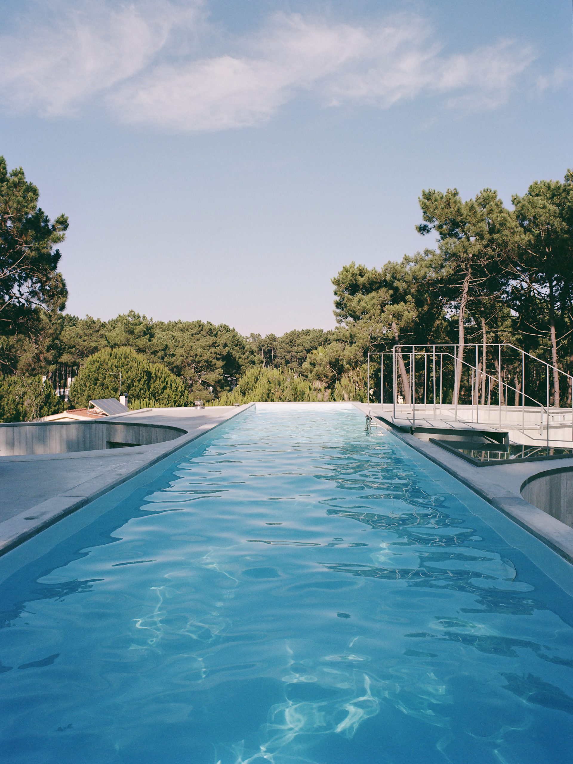 Rooftop swimming pool of Exterior of Trefoil House by Double O Studio