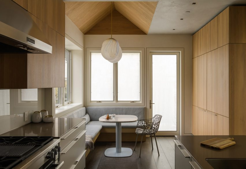 Kitchen and dining area of Music Box by CCY Architects