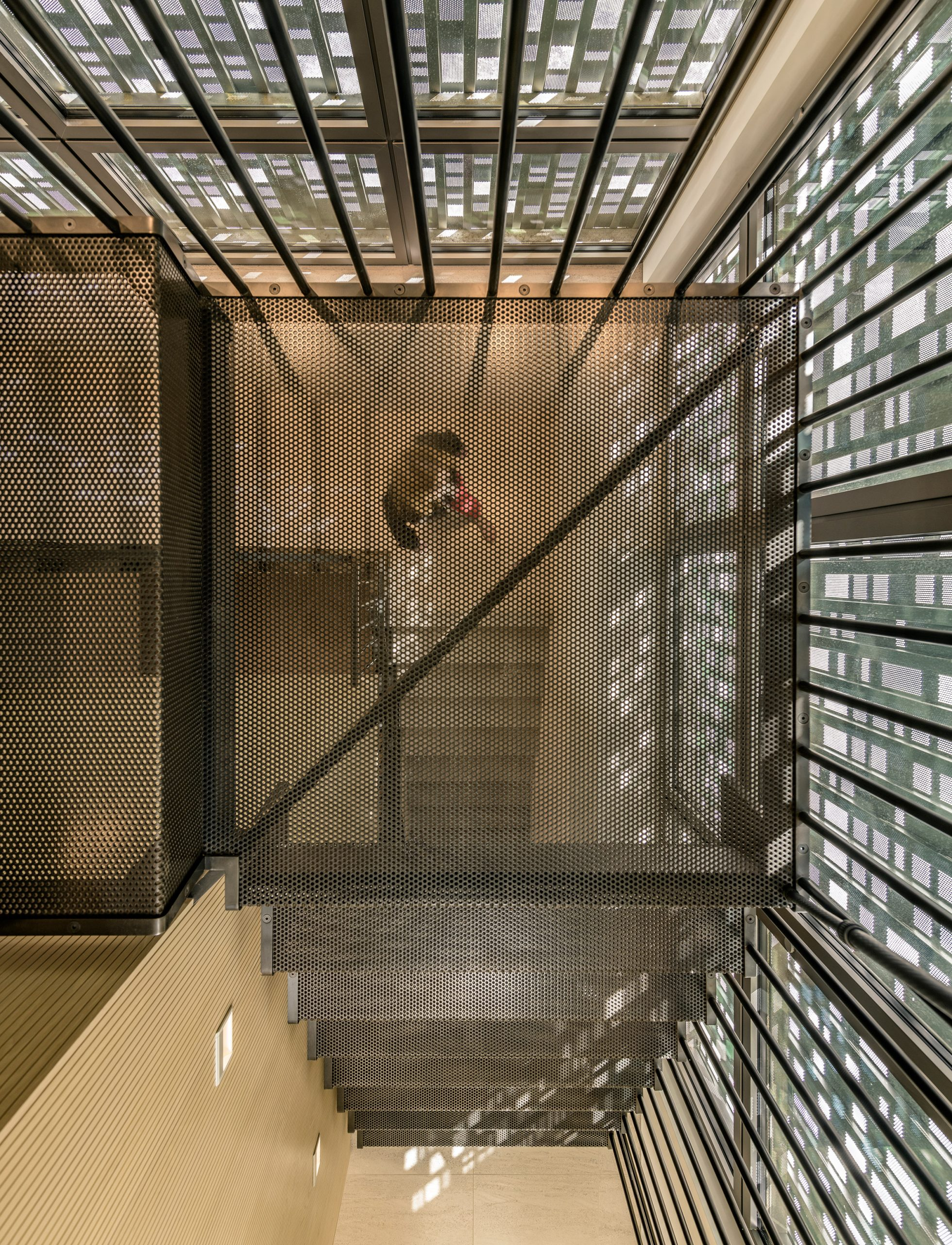 Steel mesh staircase in Music Box by CCY Architects
