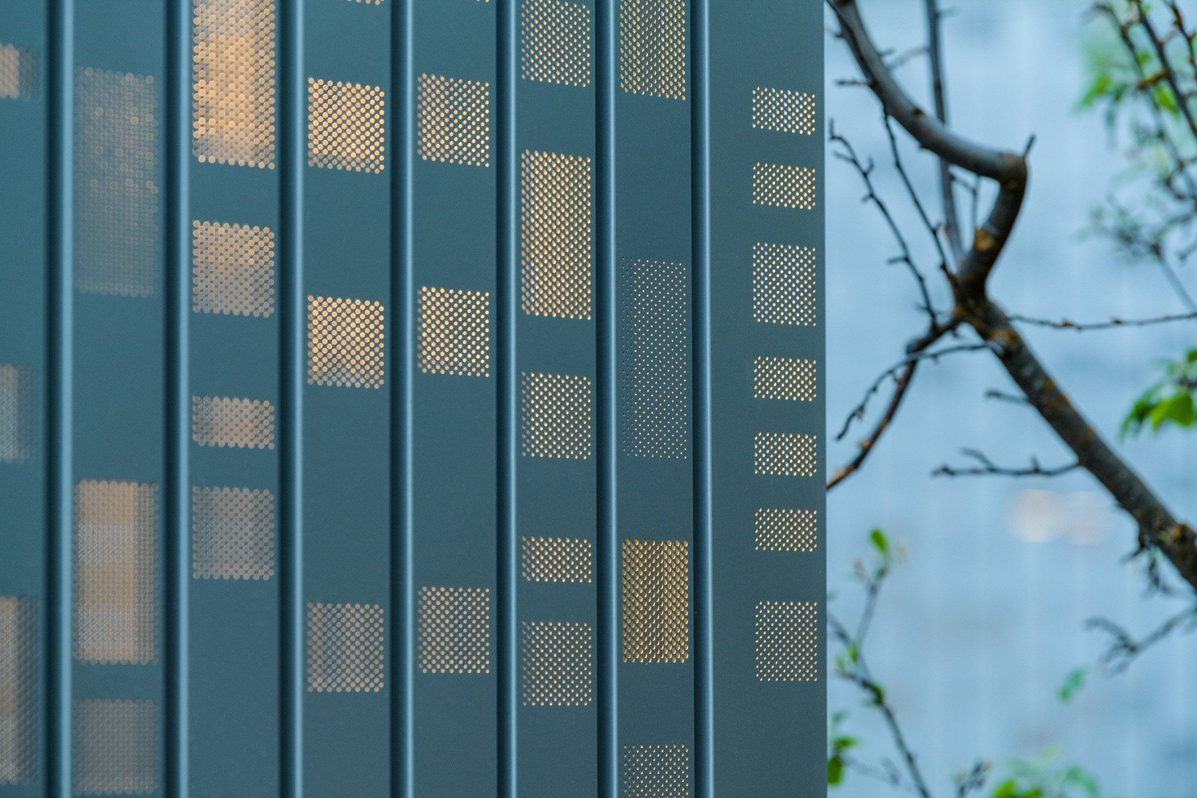 Perforated metal facade Music Box by CCY Architects