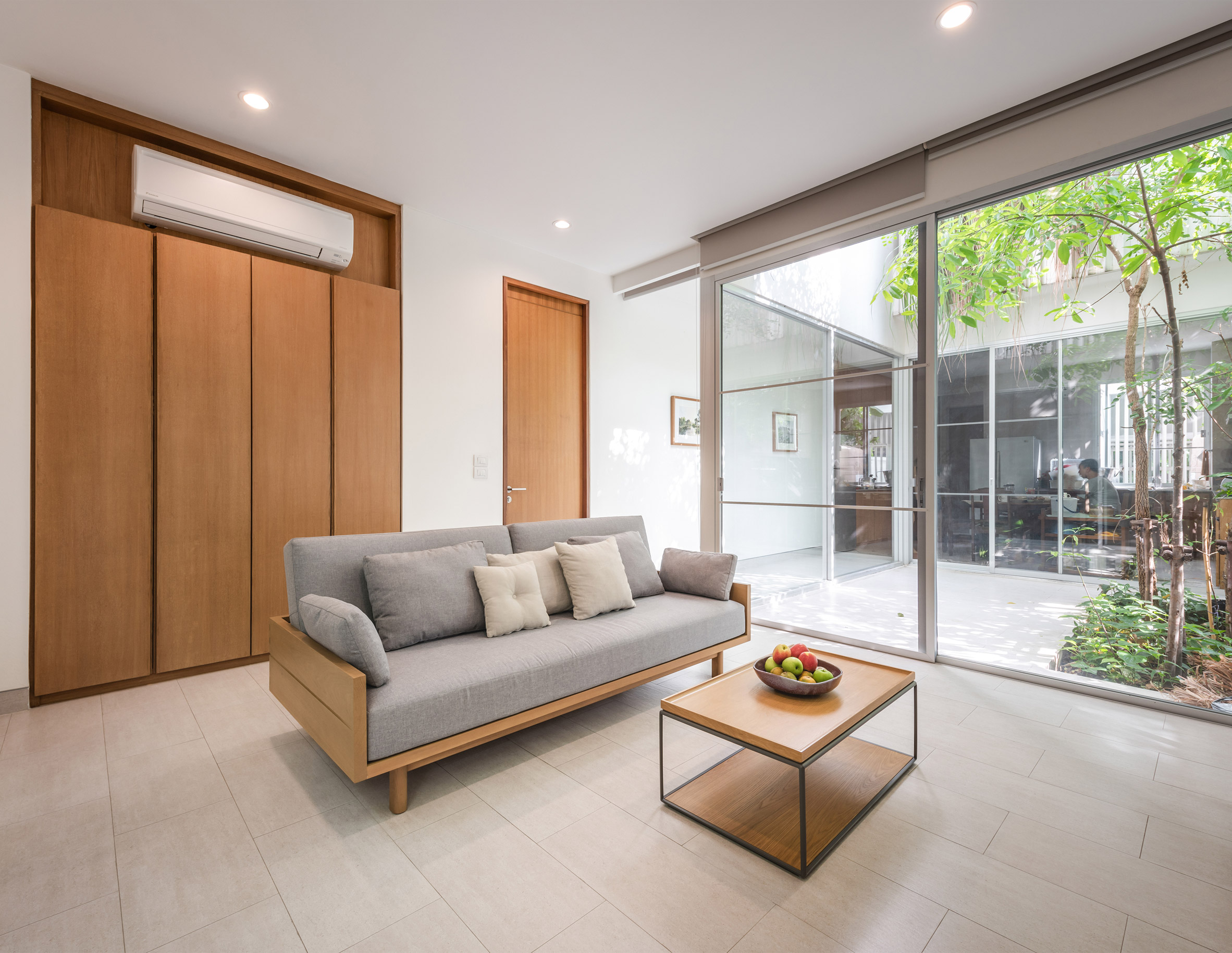 Living room and internal courtyard of the Forest House by Shma Company