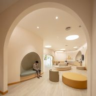 Arched doorways in children's hospital by Integrated Field