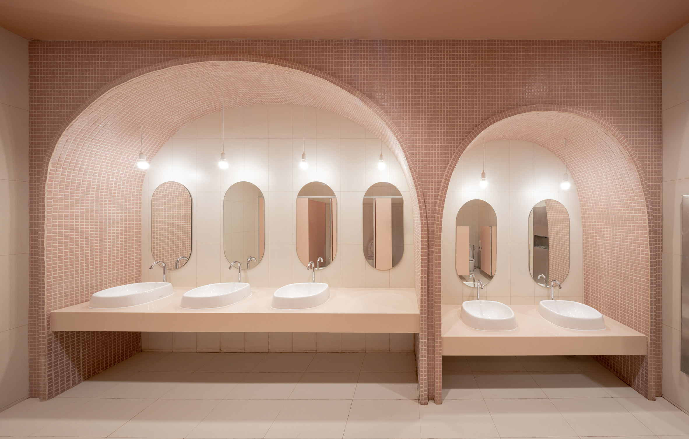 Arched pink tiled bathroom in children's hospital designed by Integrated Field