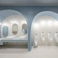 Arched blue tiled bathroom in children's hospital designed by Integrated Field