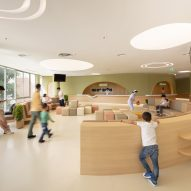 pharmacy with soft play area in children's hospital by Integrated Field