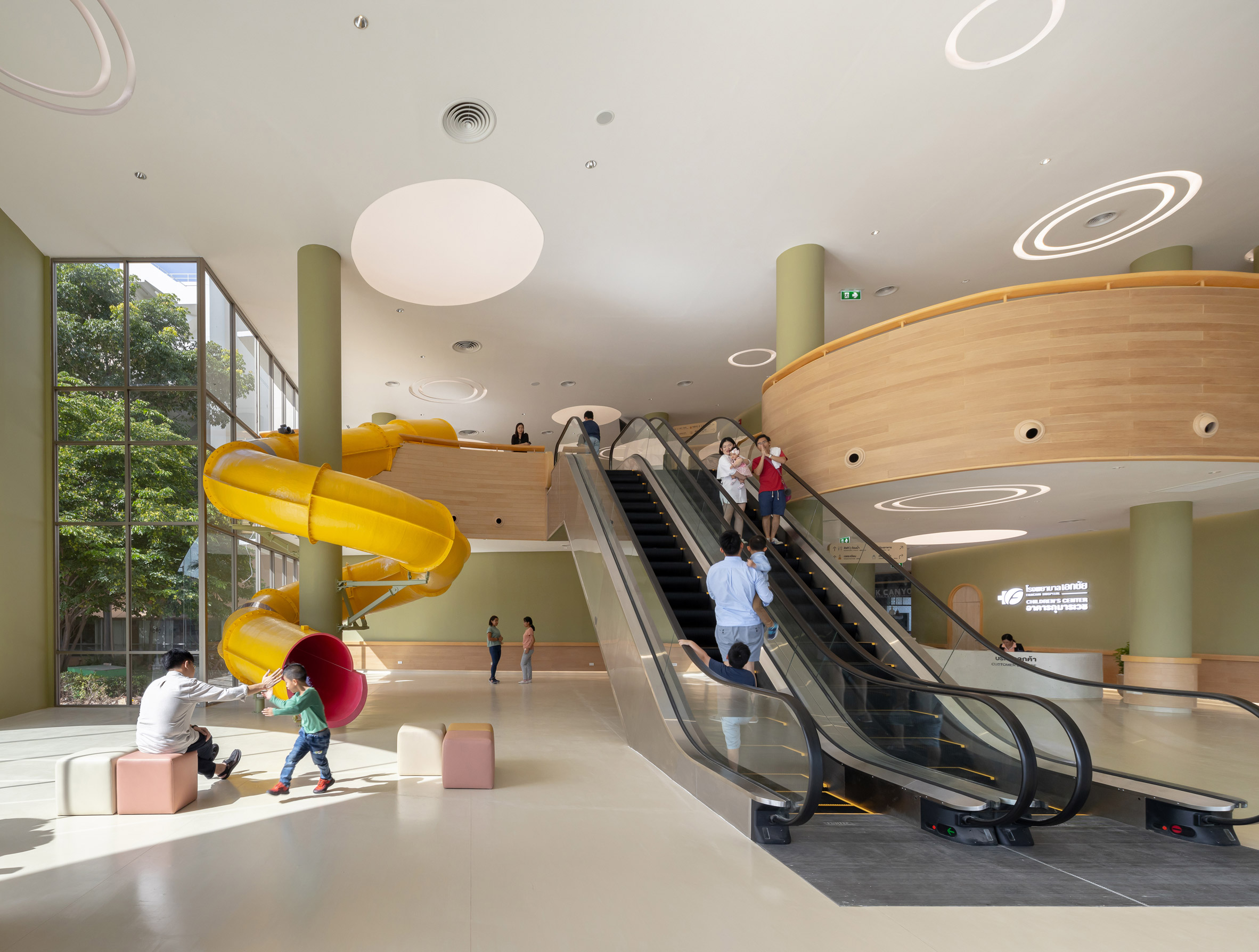 Yllow spiral slide in waiting room of children's hospital