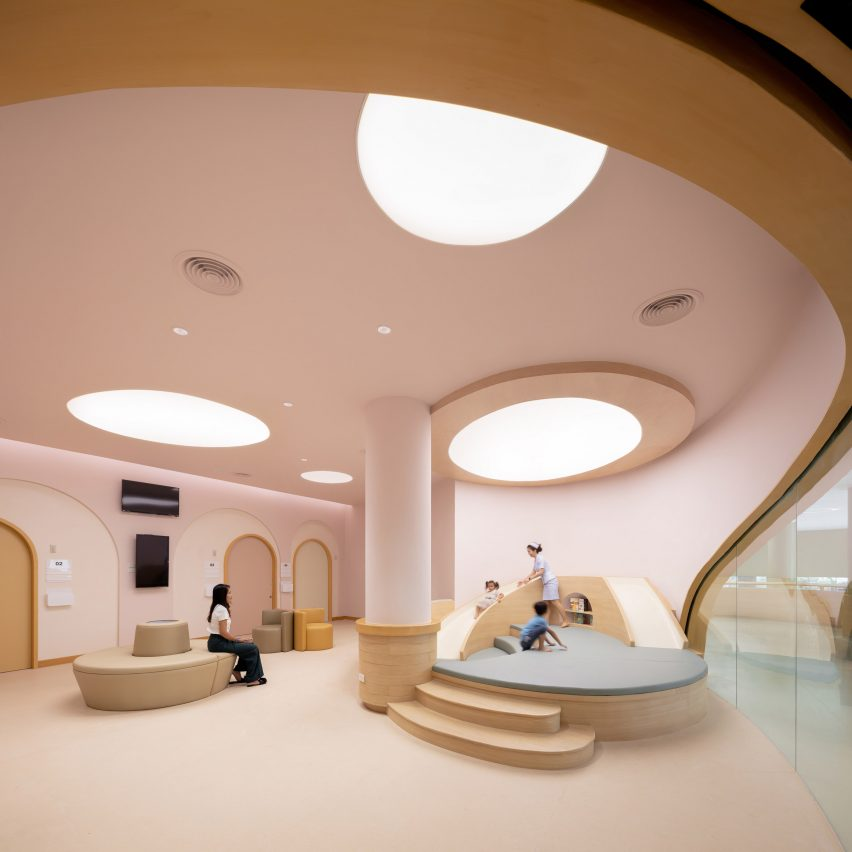 Curving pink play area in children's hospital by Integrated Field