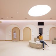Arches and curved seating in children's hospital by Integrated Field
