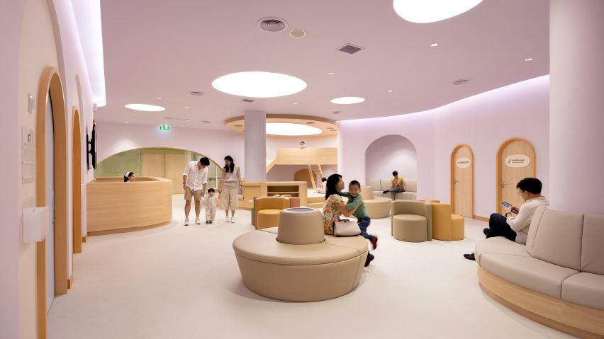 Pink waiting room in children's hospital designed by Integrated Field