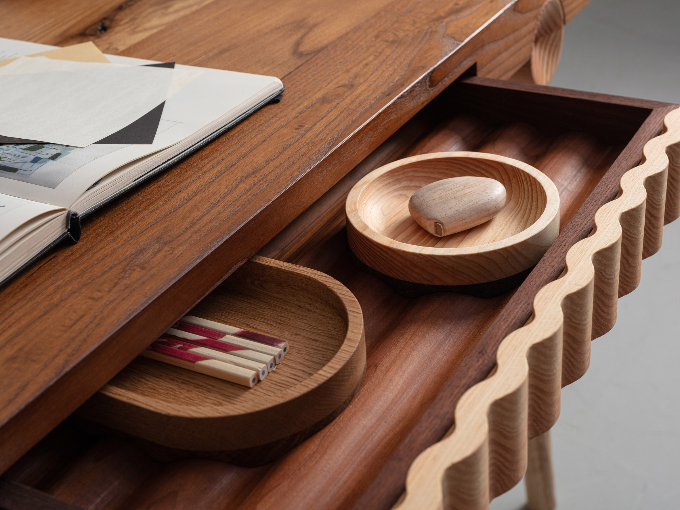 The desk and catchalls from Jan Hendzel Studio's collection made using British hardwood