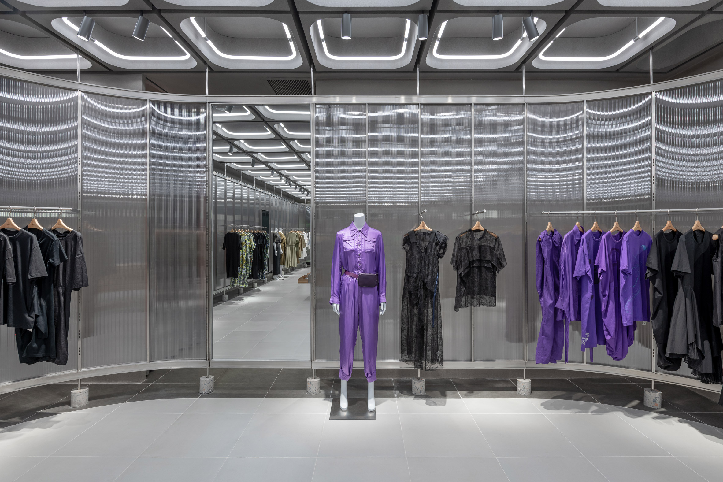 Interiors of JNBY store in Xiamen, China feature concrete, steel and glass