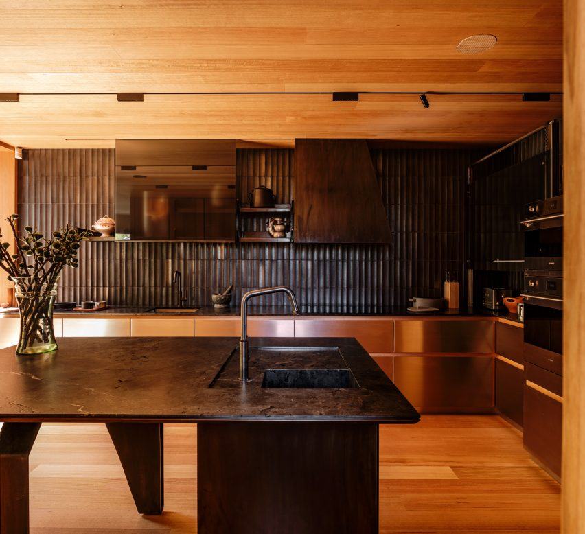 Kitchen with Japanese tiles in Kew Residence by John Wardle Architects in Melbourne, Australia