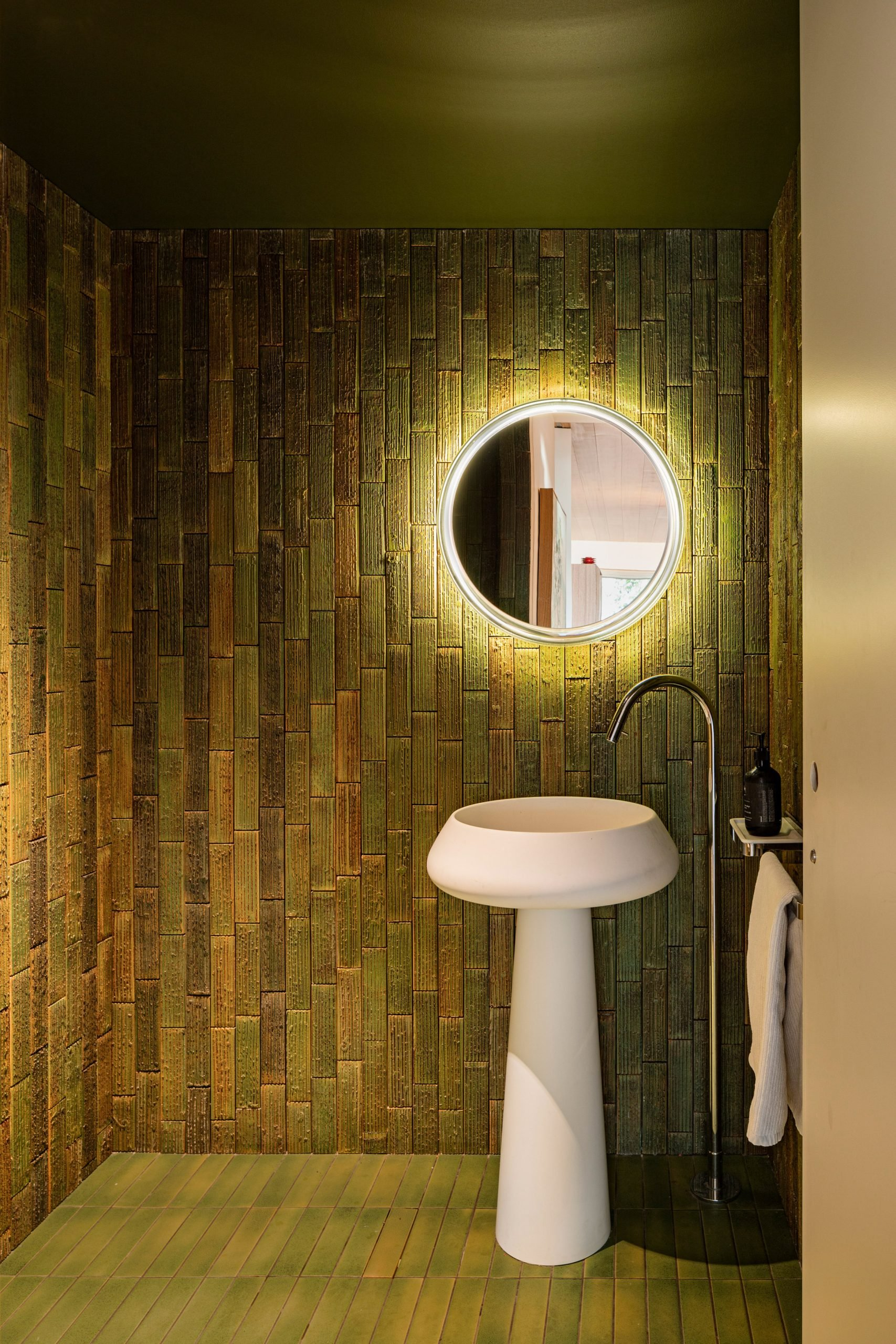 Japanese Inax tiles in bathroom in Kew Residence by John Wardle Architects in Melbourne, Australia