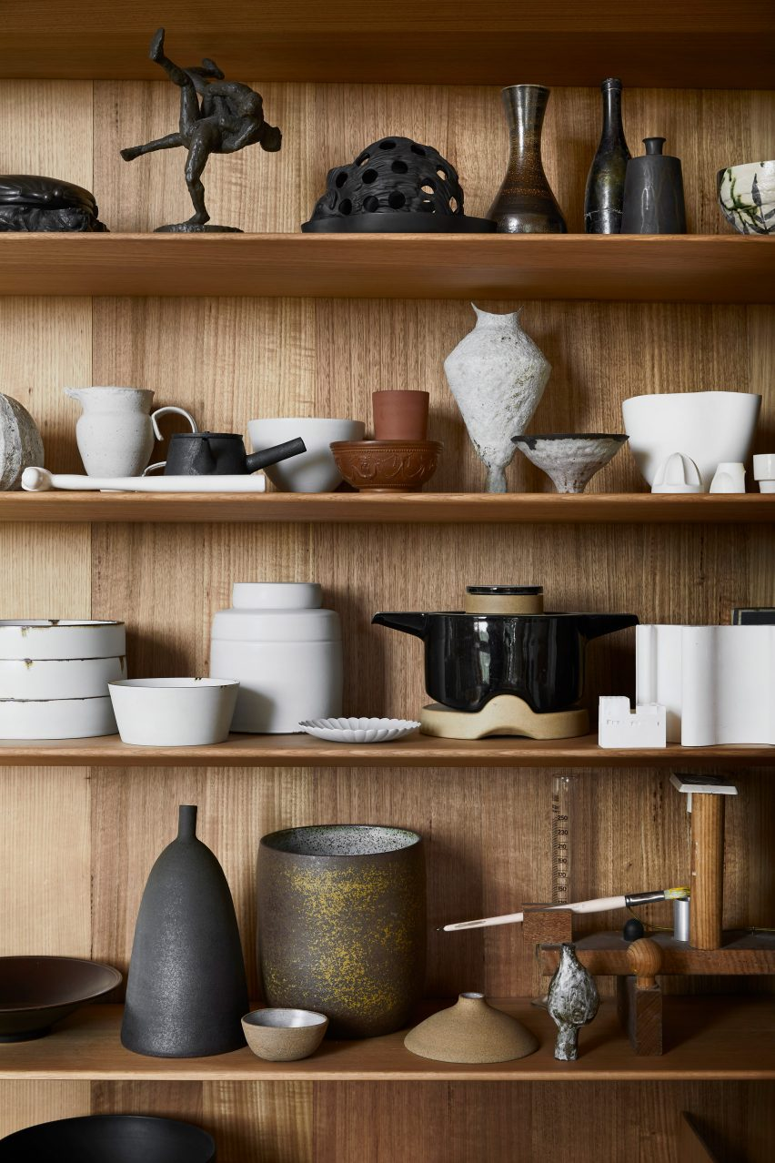 Shelf of ceramics in Kew Residence by John Wardle Architects in Melbourne, Australia