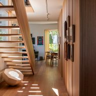 Corridor in Kew Residence by John Wardle Architects in Melbourne, Australia