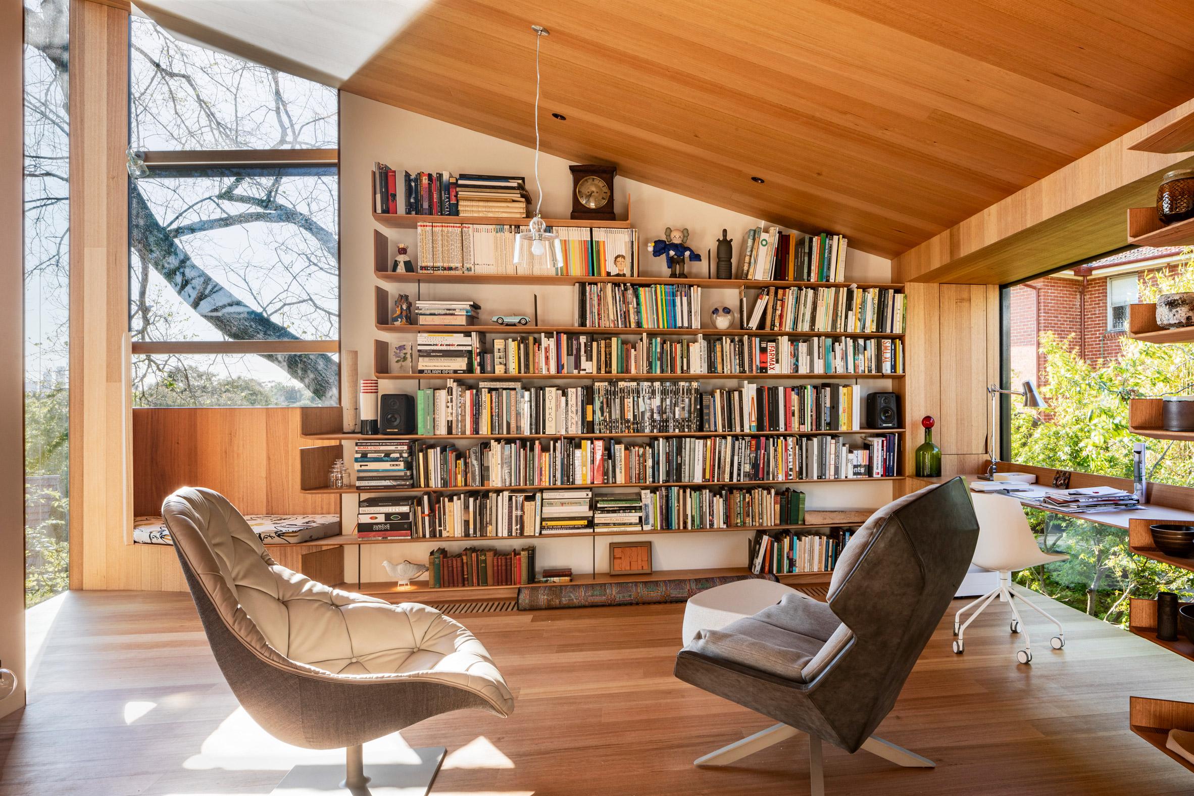 Study bookshelves in Kew Residence by John Wardle Architects in Melbourne, Australia