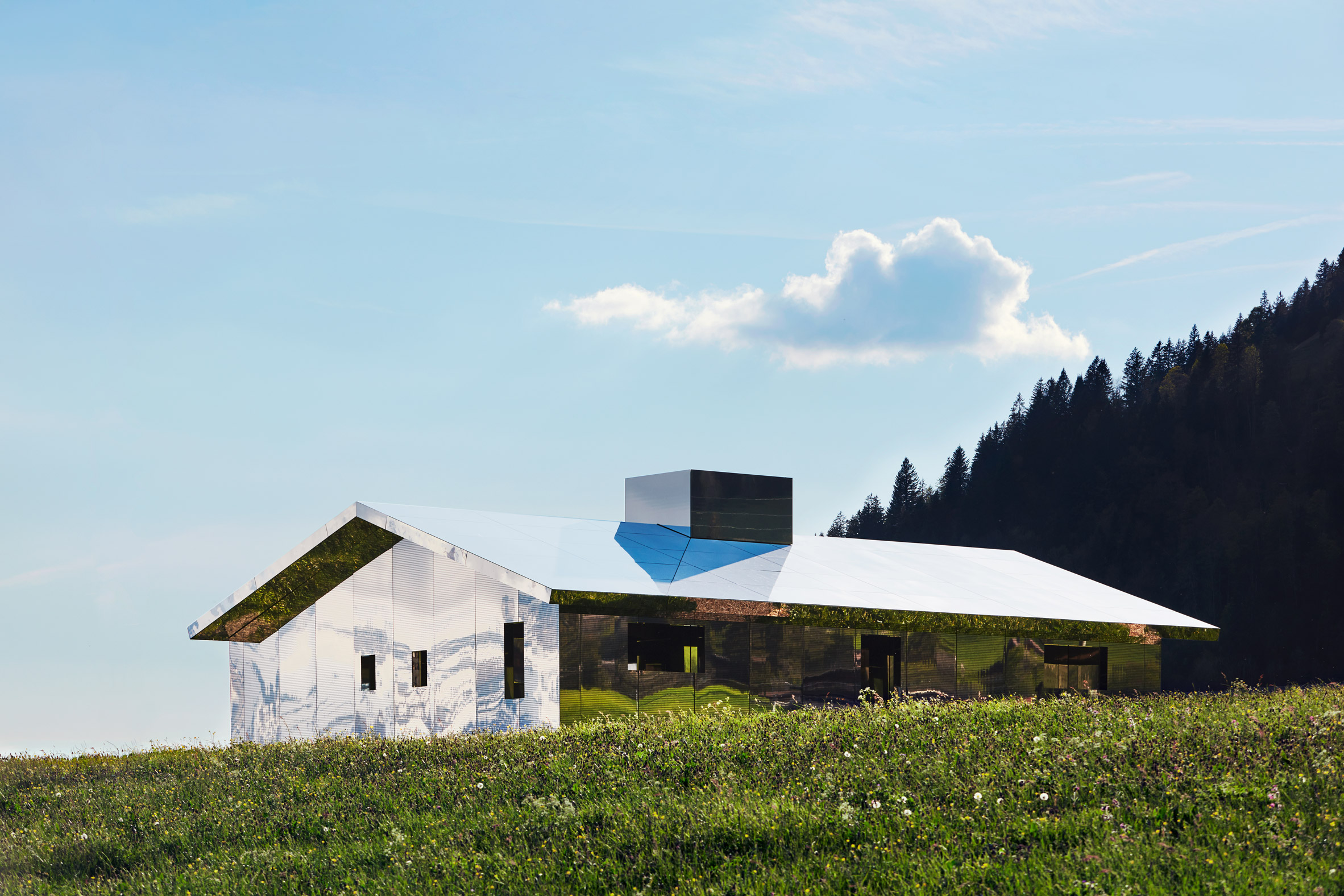 Mirage Gstaad mirrored building art installation by Doug Aitken in Switzerland in summer
