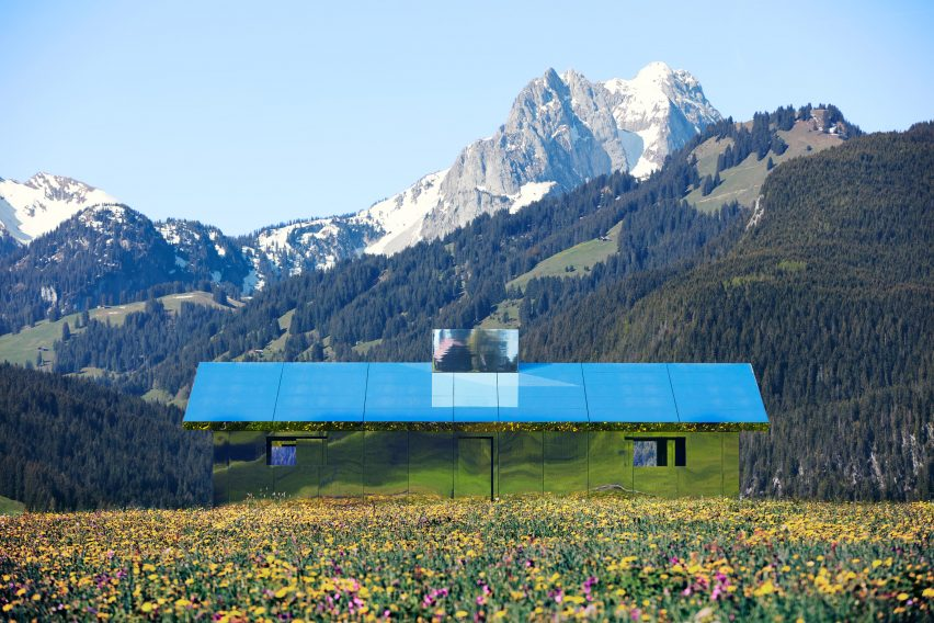 Mirage Gstaad mirrored building art installation by Doug Aitken in Switzerland in spring