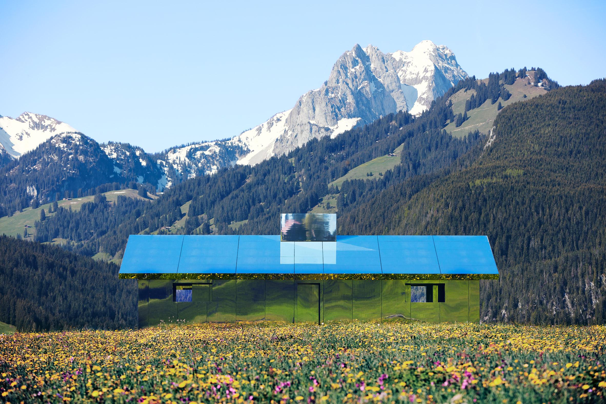 Mirage Gstaad mirrored building art installation by Doug Aitken in Switzerland in spring