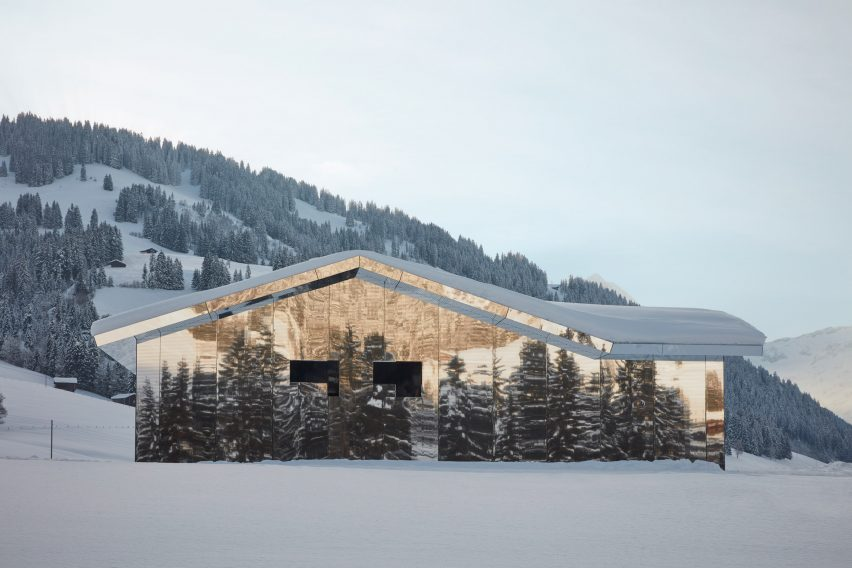 Mirage Gstaad mirrored building art installation by Doug Aitken in Switzerland in winter