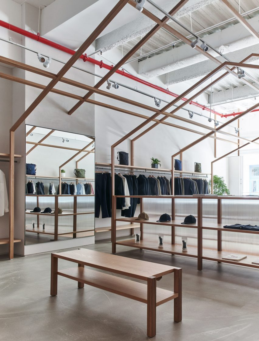 Gabled structures in Nanamica store by Taichi Kuma