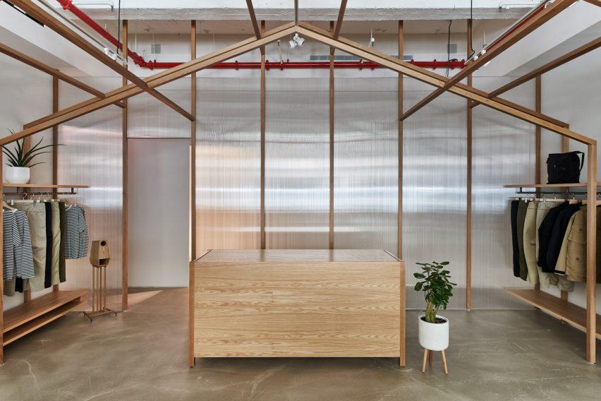 Corrugated plastic walls in Nanamica store by Taichi Kuma