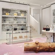 Patagonia granite and wooden logs decorate Off-White's first store in Milan