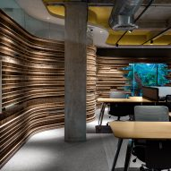 Studio VDGA lines office in India with curving walls of honeycomb cardboard