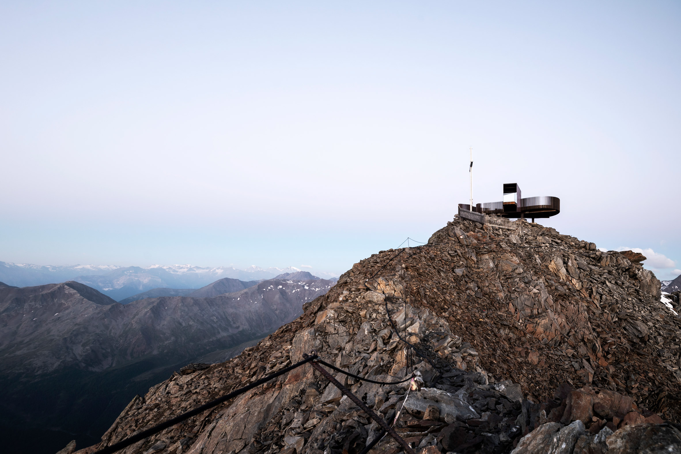 Viewing platform overlooks glacier on top of mountain ridge in South Tyrol