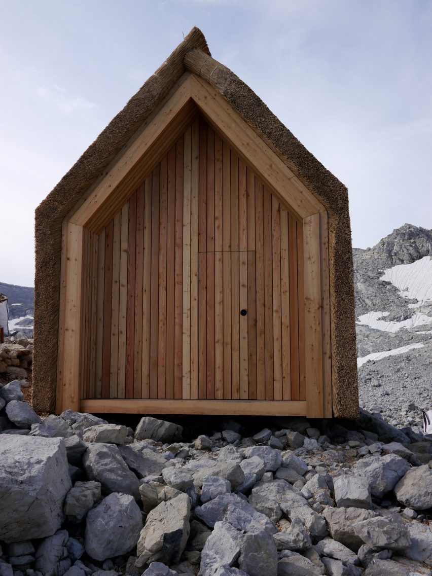 Exterior of thatched Alpine hut by University of Stuttgart