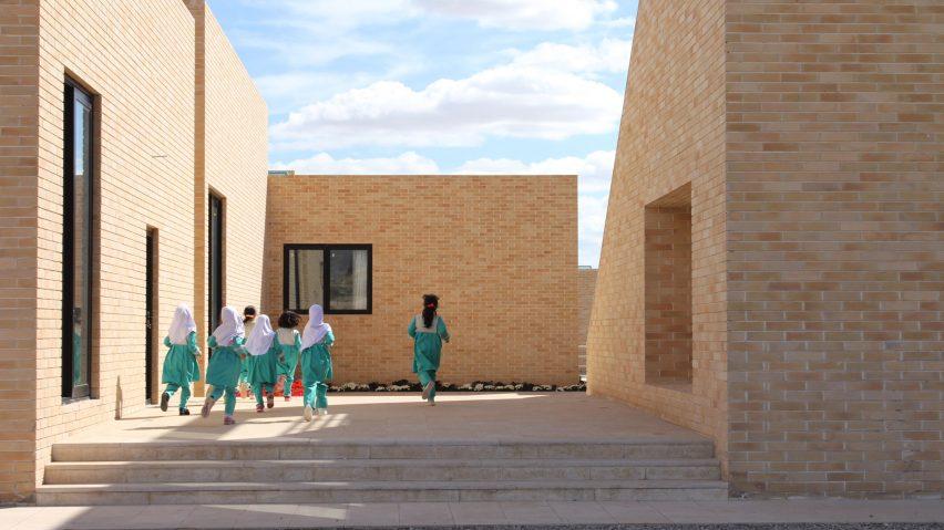 The Noor E Mobin G2 Primary School by FEA Studio made of brick in Iran