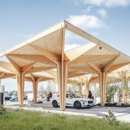 Cobe unveils pair of tree-like timber charging stations for electric cars in Denmark