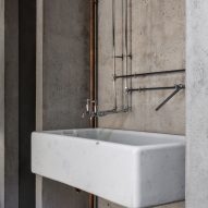 Kitchen sink and metal taps in Untiled House extension by Szczepaniak Astridge in London