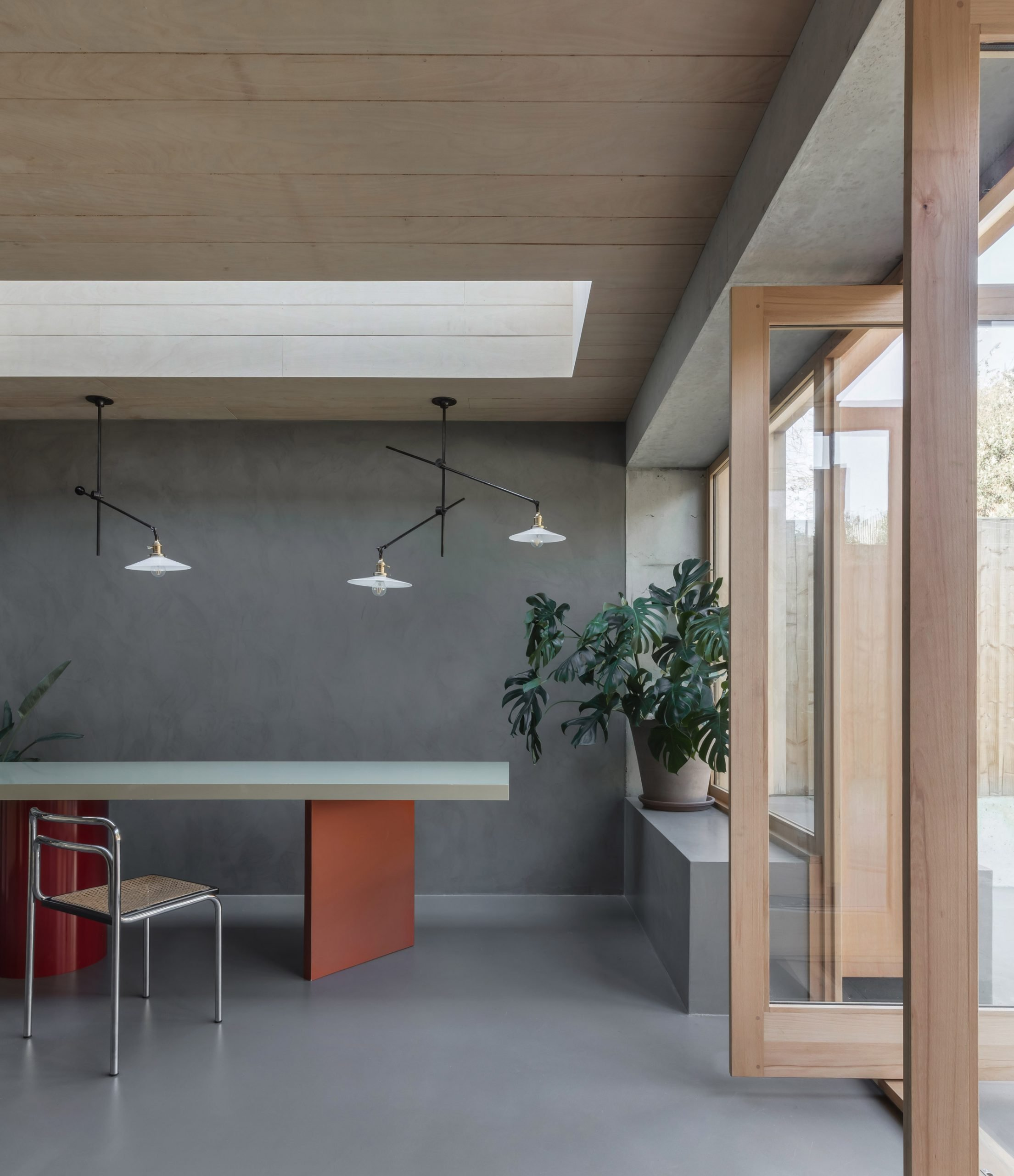 Skylight above dining table in Untiled House extension by Szczepaniak Astridge in London