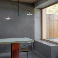 Dining table in kitchen of Untiled House extension by Szczepaniak Astridge in London